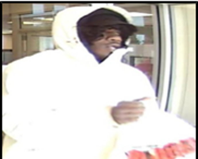 The man whom the FBI is calling the Beltway Bank Bandit, at the SunTrust Bank in Accokeek, Md., Feb. 13, 2018. (Courtesy FBI)