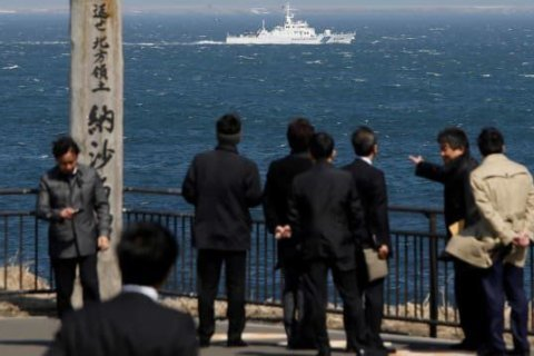 Search on after Japanese island 'disappears'