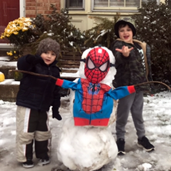 A couple of local kids pay tribute to the late, great Stan Lee as wintry weather hits the D.C. area. (Courtesy Larry Graham)