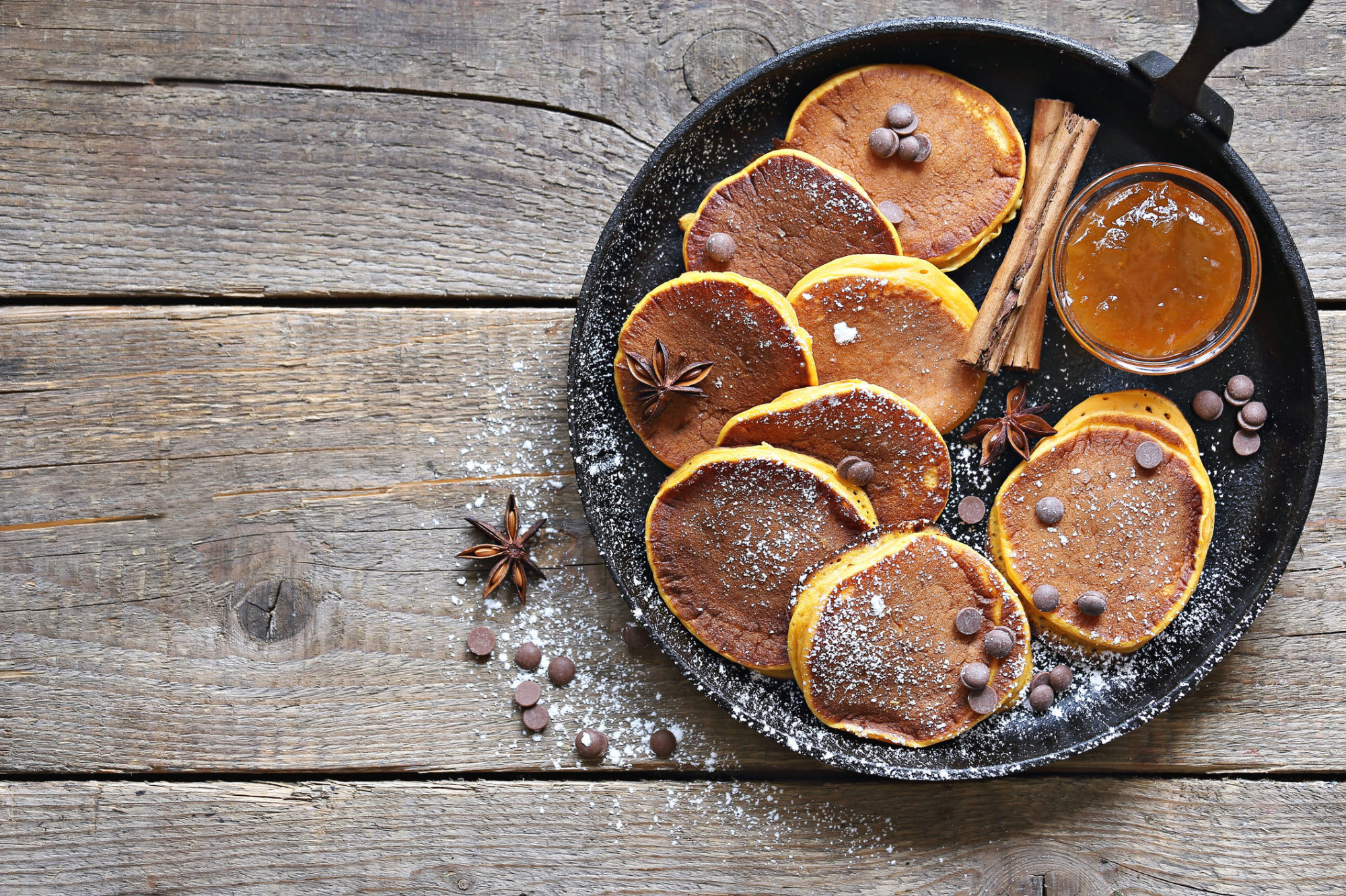 Pumpkin pancakes with chocolate chips. Overhead view