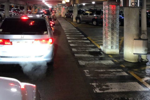 Heading home: Travelers hit traffic snags accessing Reagan National Airport Sunday night