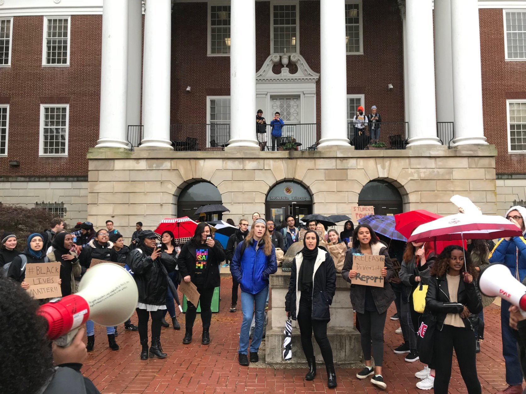 The students said they want Loh to fulfill his pledge to step down in June. (WTOP/Dick Uliano)