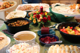 Casual Thanksgiving dinner table spread with multiple traditional dishes