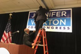 Workers put the finishing touches on what they hoped would be Jennifer Wexton's victory celebration Tuesday. (WTOP/Dick Uliano)