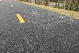 Chalk marks trail-goers enthusiasm for the new Washington Boulevard Trail. (A bridge built for the Washington Boulevard Trail. (Courtesy Arlington Department of Environmental Services)