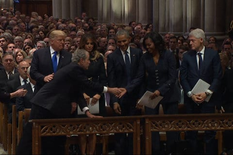 Video shows George W. Bush appearing to slip candy to Michelle Obama at funeral for George HW Bush