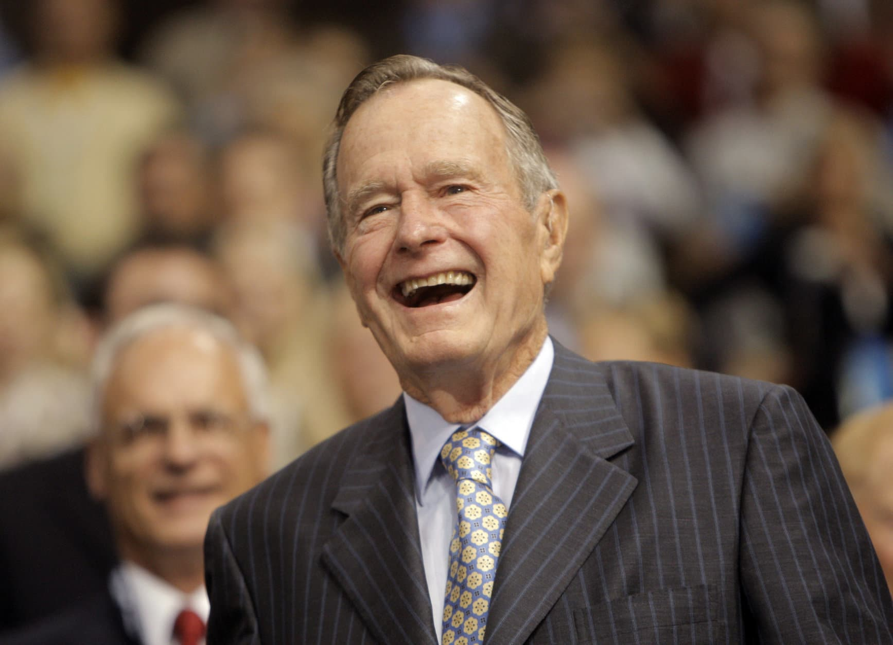 Former President George H.W. Bush smiles as he arrives at the Republican National Convention in St. Paul, Minn., Tuesday, Sept. 2, 2008. (AP Photo/Jae C. Hong)