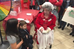 """Mrs. Claus was on hand to read """"The Night Before Christmas"""" to Nikolas. (WTOP/John Domen)"""