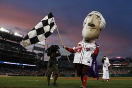 Washington Nationals racing presidents mascot Thomas Jefferson wins the race during the fourth inning of a baseball game between the Nationals and the Miami Marlins, Thursday, Aug. 10, 2017, in Washington. The Nationals won 3-2. (AP Photo/Carolyn Kaster)