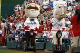 Washington Nationals Racing Presidents, President Teddy Roosevelt and President George Washington use Segways during their race during a baseball game against the Chicago Cubs at Nationals Park, Monday, June 13, 2016, in Washington. (AP Photo/Alex Brandon)