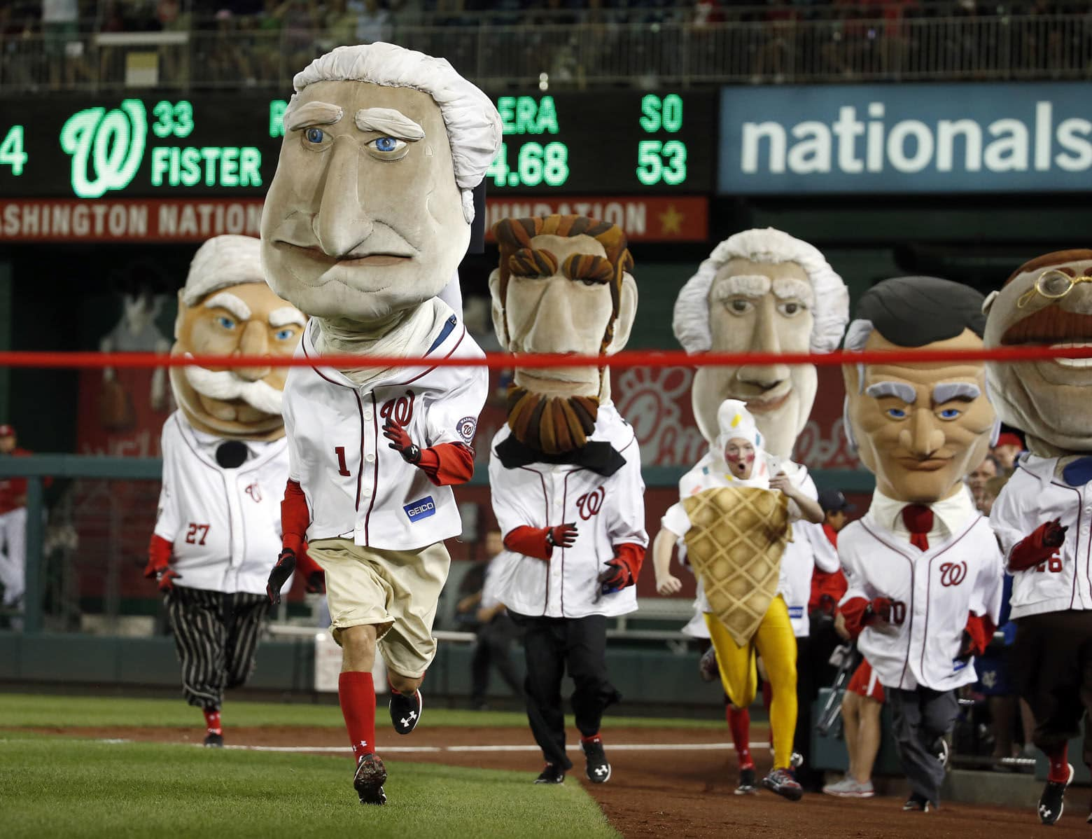 The Racing Presidents Washington Nationals mascots run during a baseball game against the San Diego Padres at Nationals Park, Wednesday, Aug. 26, 2015, in Washington. (AP Photo/Alex Brandon)