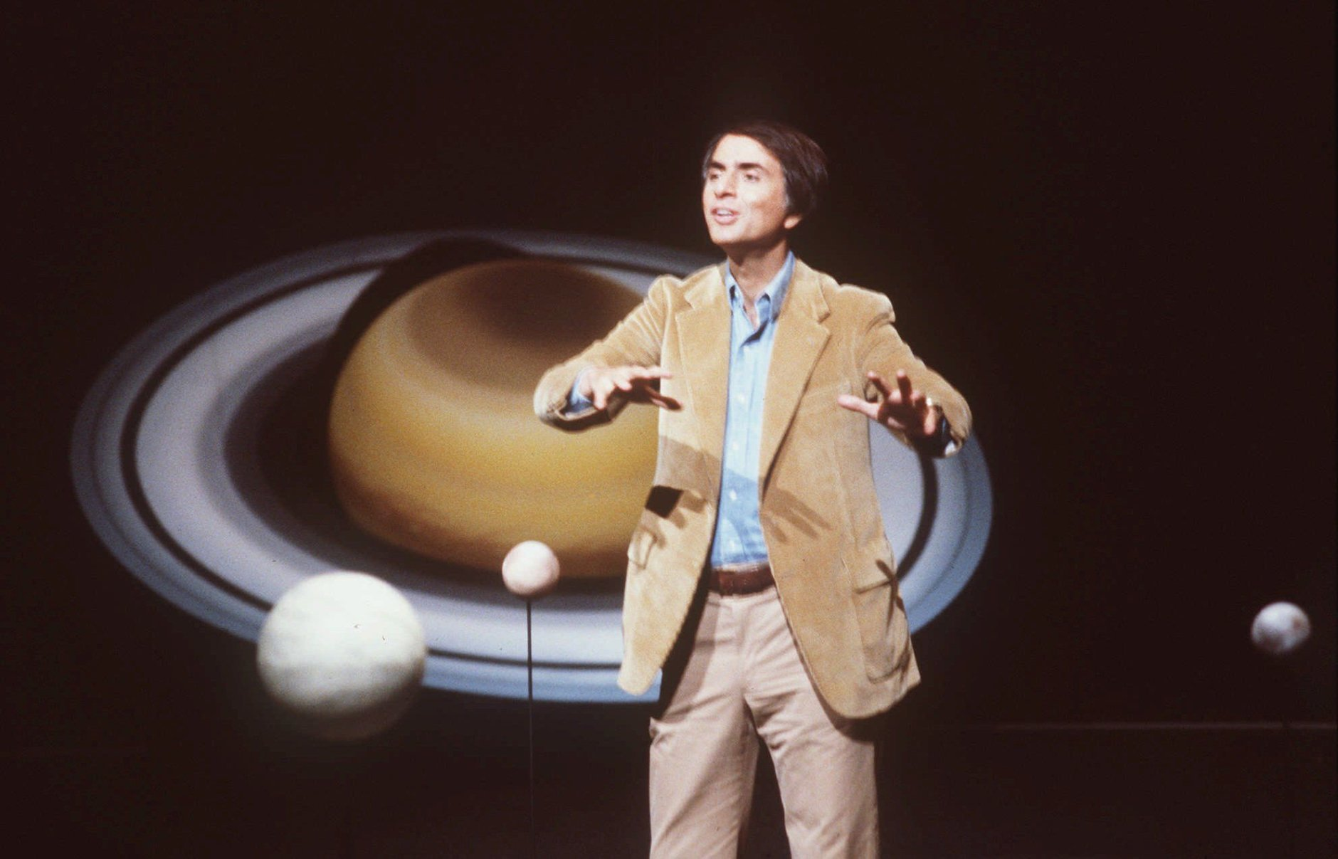 "In this 1981 file photo, astronomer Carl Sagan speaks during a lecture. On Saturday, May 9, 2015, Cornell University announced that its Institute for Pale Blue Dots is to be renamed the Carl Sagan Institute. Sagan was famous for extolling the grandeur of the universe in books and shows like ""Cosmos."" He died in 1996 at age 62. (AP Photo/Castaneda, File)"