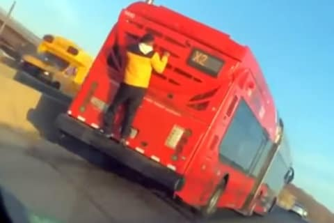 VIDEO: Teen clings to back of X2 bus