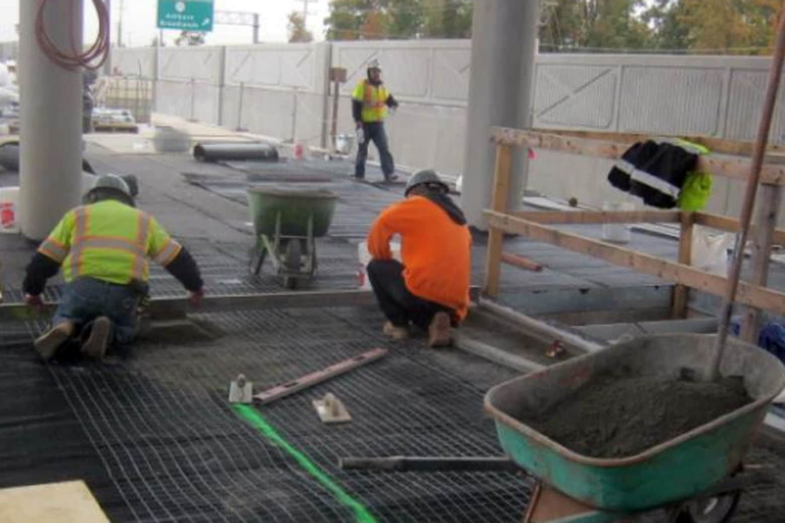 Workers doing paver placement at the Ashburn station. (Courtesy Metropolitan Washington Airports Authority)