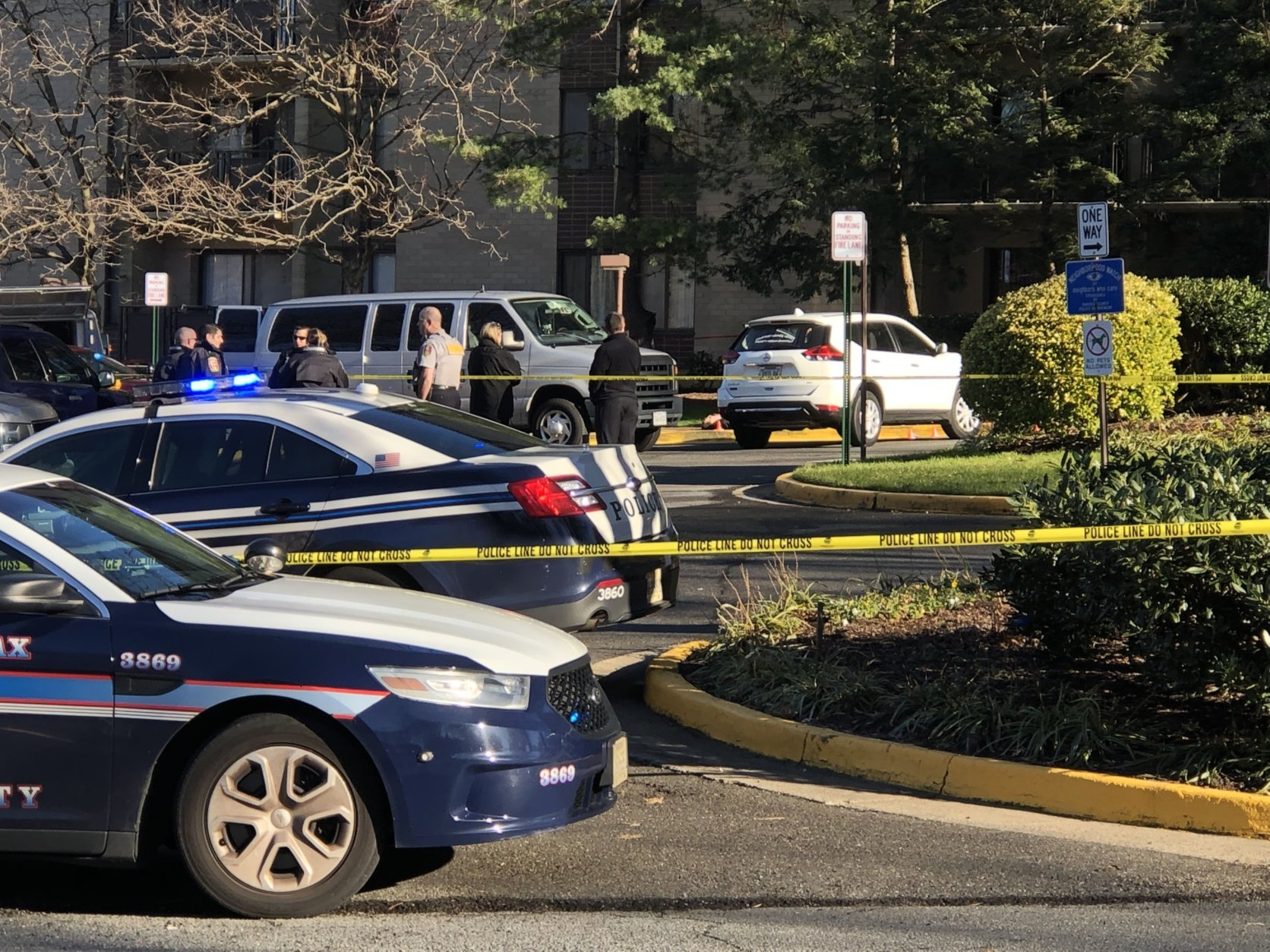 Police think a man in Falls Church hit a woman with a car before shooting her and then himself. (WTOP/Kristi King)