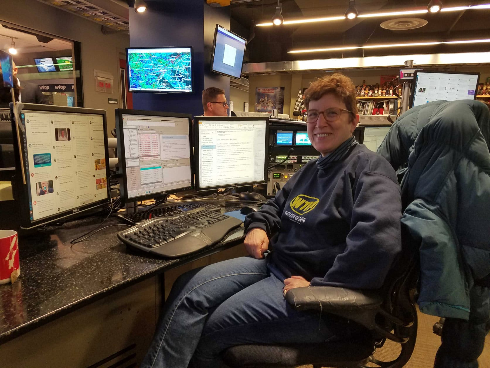 Judy Taub is in control, leading WTOP's coverage of everything from news to sports to weather and traffic. (WTOP/Will Vitka)