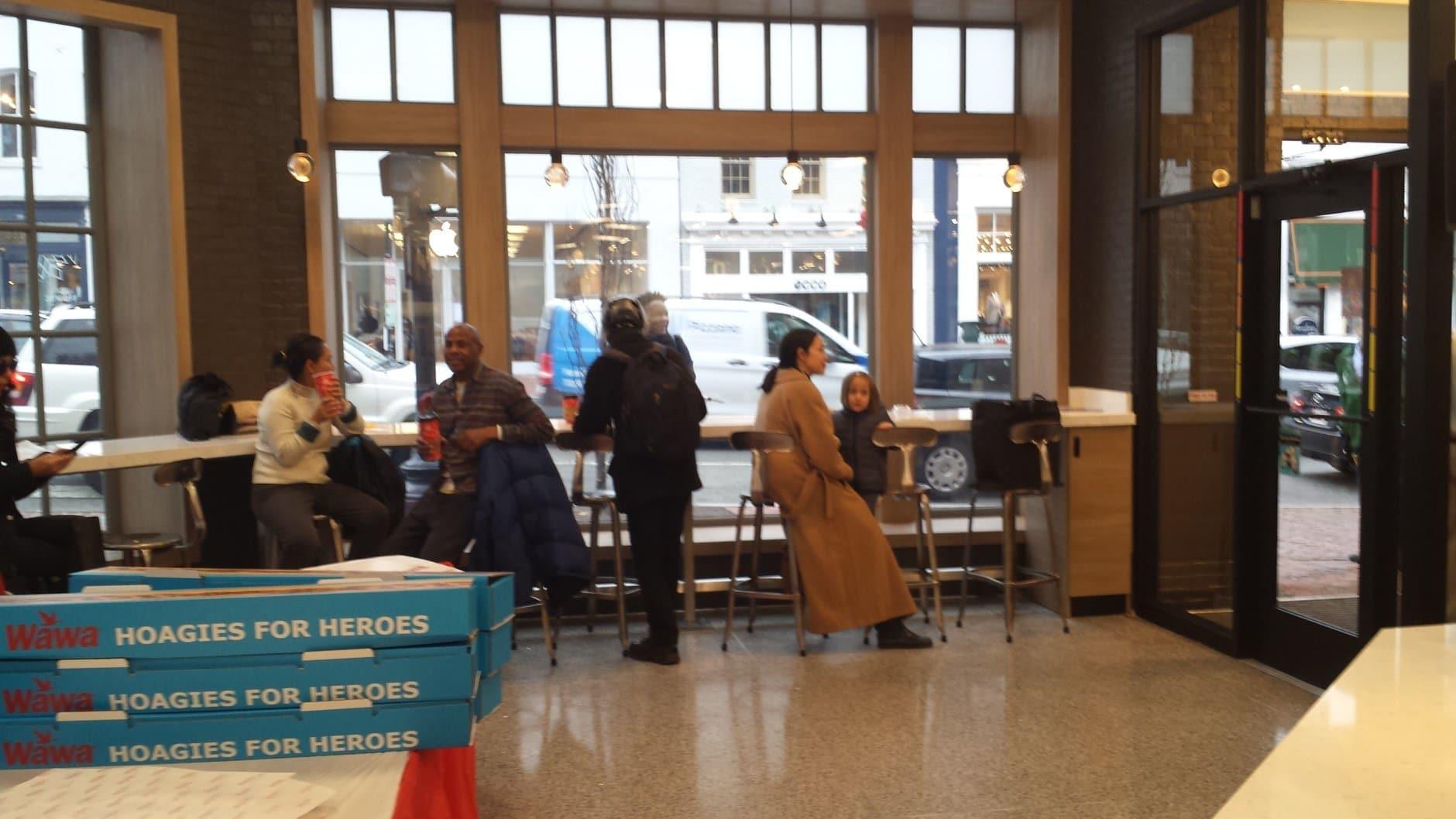 Customers gather inside WAWA's new Georgetown store. A new WAWA will soon open up in Tenleytown. (WTOP/Matt Ritter)