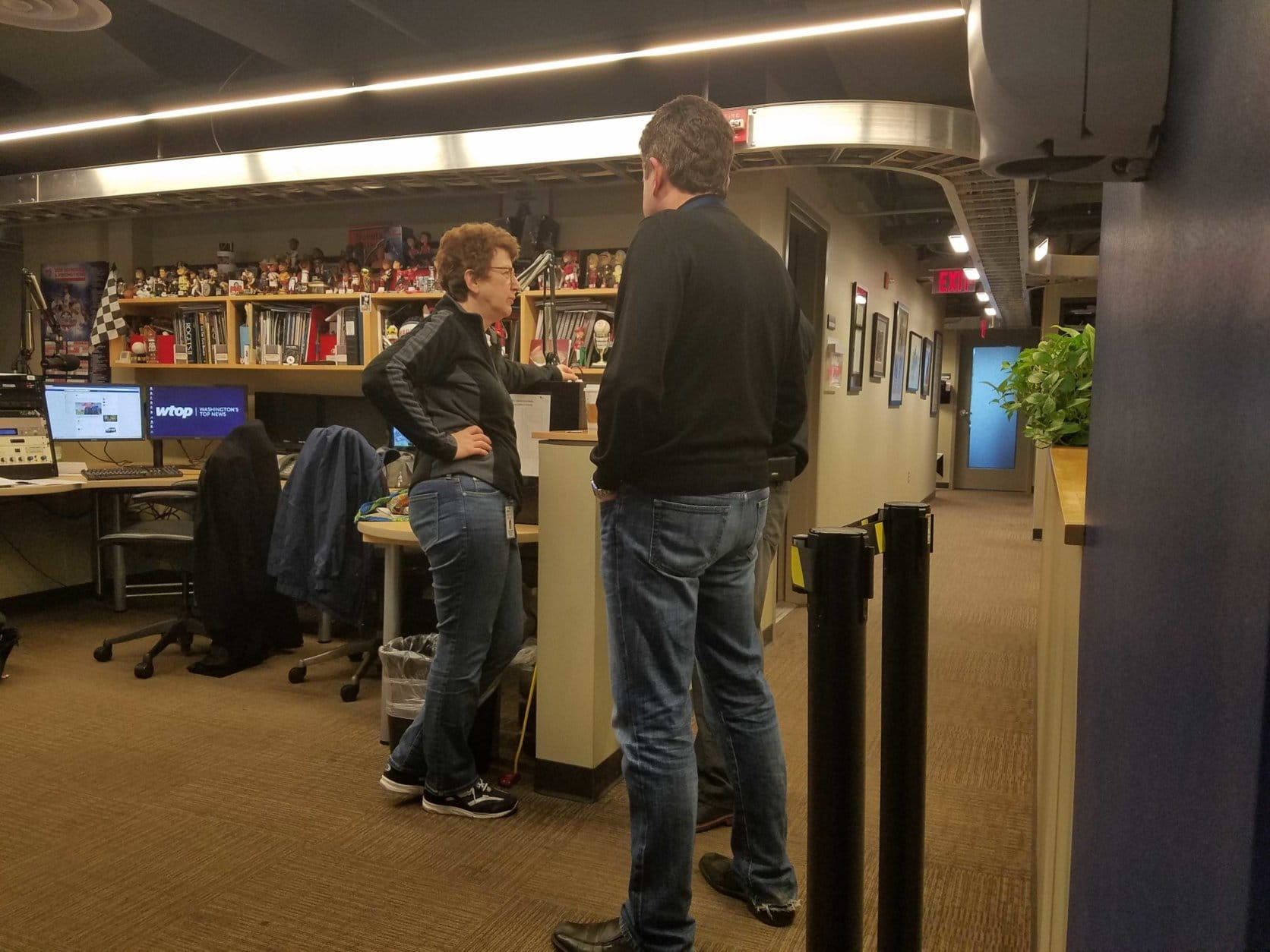 WTOP legend Judy Taub with sports expert Dave Johnson. (WTOP/Will Vitka)