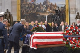 """Jonathan Bush, brother of the late President George H.W. Bush, places his hand on his brother's coffin during the lying-in-state on December 4, 2018. (Courtesy Shannon Finney/<a href=""""https://www.shannonfinneyphotography.com/index"""" target=""""_blank"""" rel=""""noopener noreferrer"""">shannonfinneyphotography.com</a>)"""