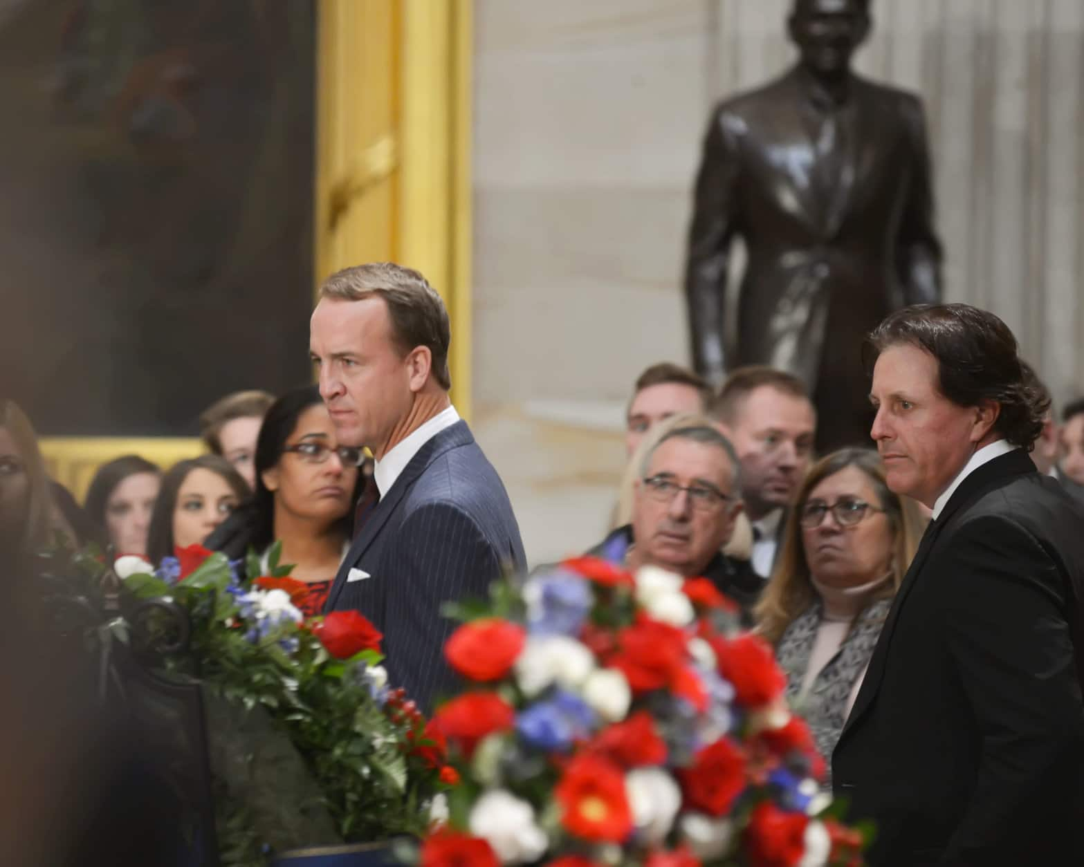 "Retired quarterback Peyton Manning and golfer Phil Mickelson attend the lying-in-state for the late President George H.W. Bush on Dec. 4, 2018. (Courtesy Shannon Finney/<a href=""https://www.shannonfinneyphotography.com/index"" target=""_blank"" rel=""noopener noreferrer"">shannonfinneyphotography.com</a>)"