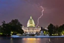 Spring thunderstorms danced across the skies during a stormy period beginning on Mother's Day weekend. Lightning flickered behind the U.S. Capitol late that Saturday. High winds ahead of the storms forced officials to stop traffic on Route 50 at the Bay Bridge for a time. (WTOP/Dave Dildine)