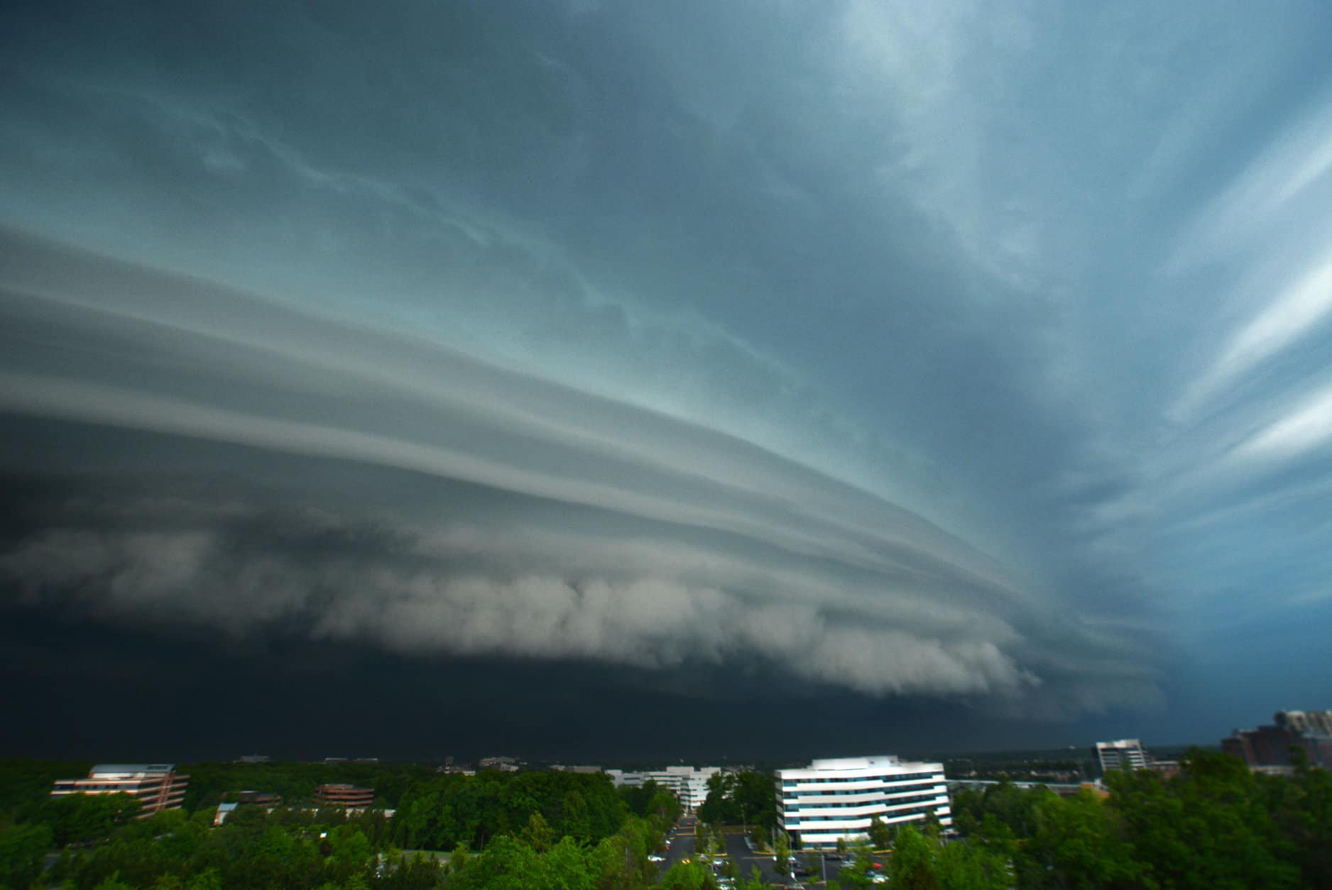The stormy conditions culminated on Monday afternoon as a giant squall line swept across the region. An ominous shelf cloud and gusty winds raced across the western suburbs. Trees were toppled and heavy rain and wind-driven hail pelted drivers during the afternoon rush hour. (WTOP/Dave Dildine)