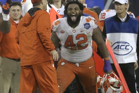 The Latest: Familiar teams battling for CFP championship