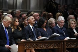 From left, President Donald Trump, first lady Melania Trump, former President Barack Obama, Michelle Obama, former President Bill Clinton and former Secretary of State Hillary Clinton listen during a State Funeral at the National Cathedral, Wednesday, Dec. 5, 2018, in Washington, for former President George H.W. Bush.(AP Photo/Alex Brandon, Pool)