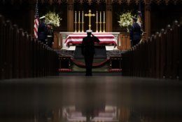 People pay their respects as the flag-draped casket of former President George H.W. Bush lies in repose at St. Martin's Episcopal Church Wednesday, Dec. 5, 2018, in Houston. (AP Photo/David J. Phillip, Pool)
