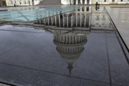 The U.S. Capitol is seen reflected after rain in Washington, Friday, Dec. 21, 2018. (AP Photo/Jose Luis Magana)