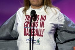 "Director Penny Marshall displays a t-shirt with a line from her film ""A League of Their Own"" as she presents the award for best sports movie during the 10th annual Espy Awards, Wednesday, July 10, 2002, in Los Angeles. The Espy Awards recognize the top achievements and perfomers in sports.  (AP Photo/Mark J. Terrill)"
