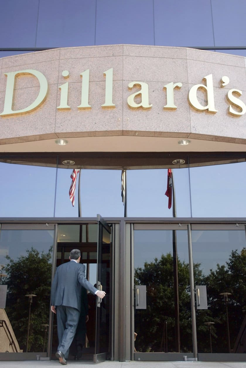 ** FILE ** An unidentified man enters Dillard's, Inc., headquarters building in Little Rock, Ark., before the company's shareholder meeting in this May 21, 2005, file photo. A federal lawsuit, filed Monday, Oct. 17, 2005,  accuses the department store chain of engaging in racial profiling in company efforts to thwart shoplifters. (AP Photo/Danny Johnston, File)