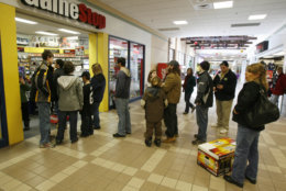 A line of shoppers extends out of the store into the mall hallway at the Game Stop store in Berlin, Vt., Friday, Dec. 26, 2008. Shoppers hit the stores early Friday to return unwanted gifts and take advantage of drastic price cuts offered by retailers desperate to get rid of old merchandise and boost their less-than-cheery holiday sales.(AP Photo/Toby Talbot)
