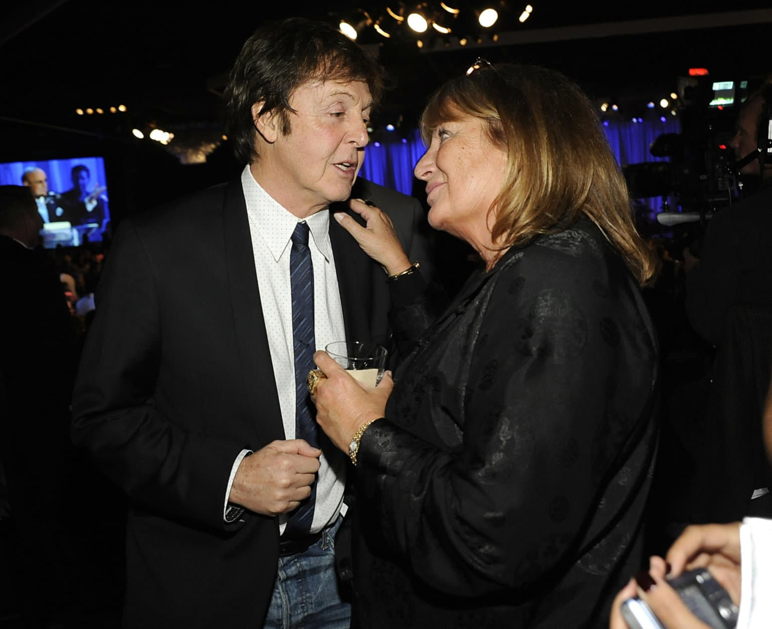 Singer and musician Paul McCartney, left, and director Penny Marshall talk at the Clive Davis pre-Grammy party in Beverly Hills, Calif. on Saturday, Feb. 7, 2009. (AP Photo/Dan Steinberg)