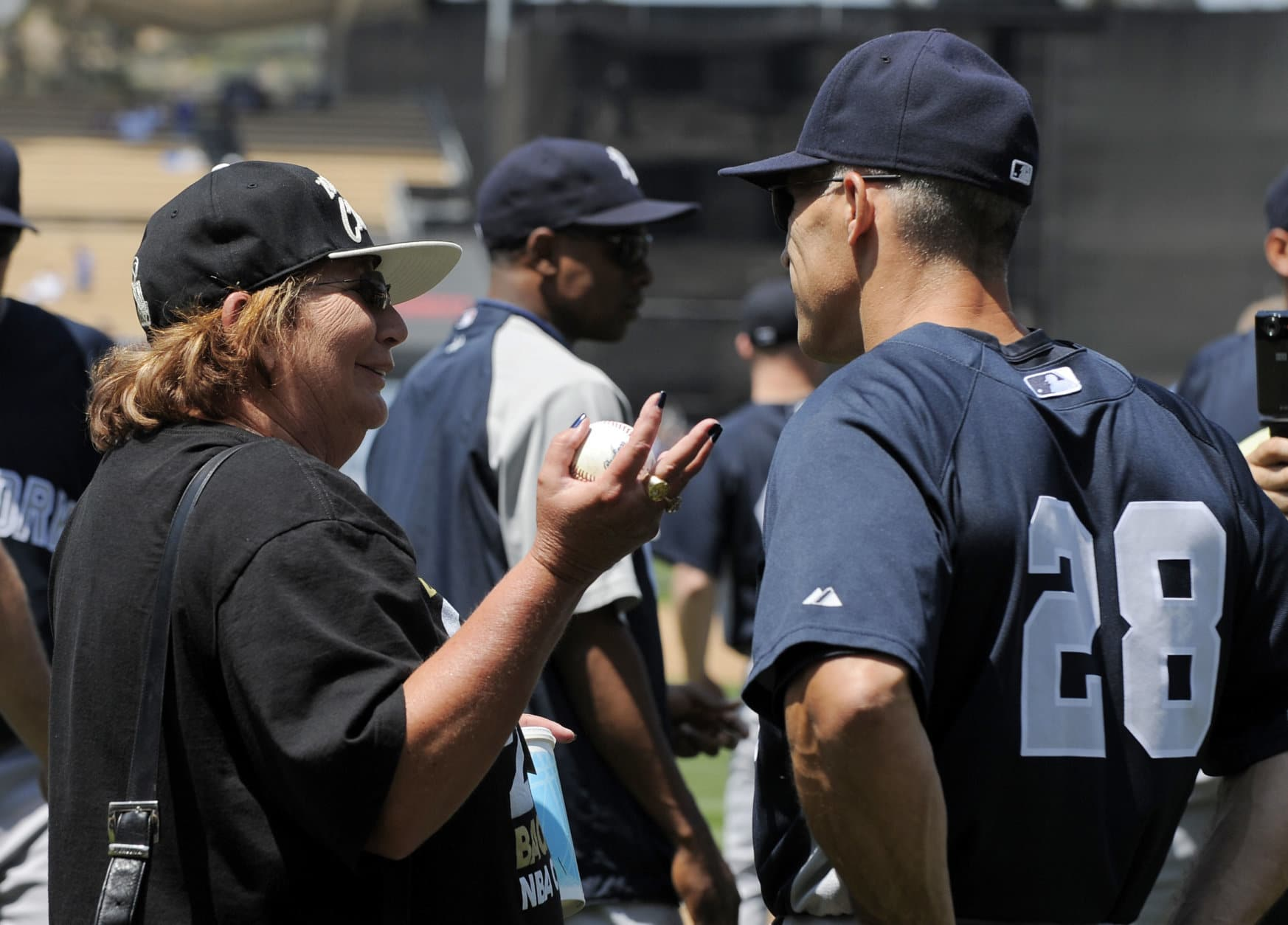 New York Yankees manager Joe Girardi, right, talks with actress Penny Marshall prior to their baseball game against the Los Angeles Dodgers, Saturday, June 26, 2010, in Los Angeles. (AP Photo/Mark J. Terrill)