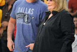 Dallas Mavericks owner Mark Cuban talks with actress Penny Marshall prior to Game 1 of a second-round NBA playoff basketball series against the Los Angeles Lakers, Monday, May 2, 2011, in Los Angeles. The Mavericks won 96-94.  (AP Photo/Mark J. Terrill)