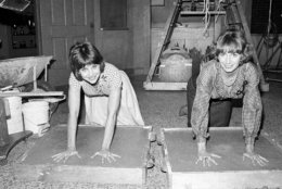 "FILE - In this , Nov. 14, 1979, file photo taken by Associated Press photographer Lennox McLendon, shows actresses Cindy Williams, left, and Penny Marshall, stars of the ABC-TV comedy series ""Laverne and Shirley,"" make an impression in cement after the taping of their show in Los Angeles. Lennox ""Red"" McLendon, a globe-trotting photographer who chronicled everything from the Vietnam War to the Academy Awards during a long career with the U.S. Navy and The Associated Press, has died at 74. McLendon died Oct. 24, 2017 in Las Vegas, according to his family. (AP Photo/Lennox McLendon, File)"