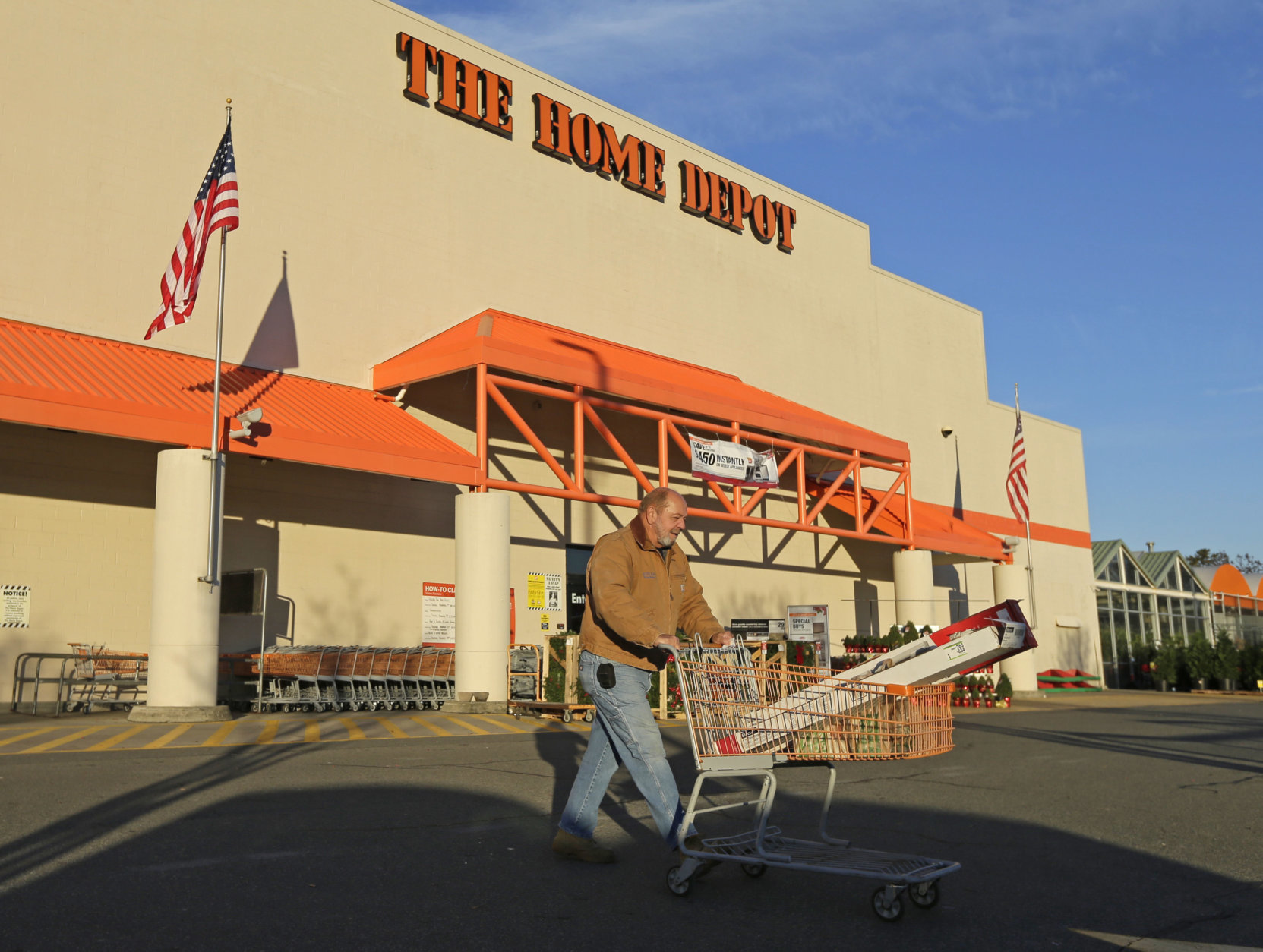 Electrical contractor Tommy Hendrick leaves a Home Depot store in Matthews, N.C., Tuesday, Nov. 18, 2014. Home Depot's third-quarter profit rose 14 percent as comparable-store sales climbed in the U.S., suggesting that a huge data breach announced two months ago has not shaken the faith of its customers. (AP Photo/Chuck Burton)