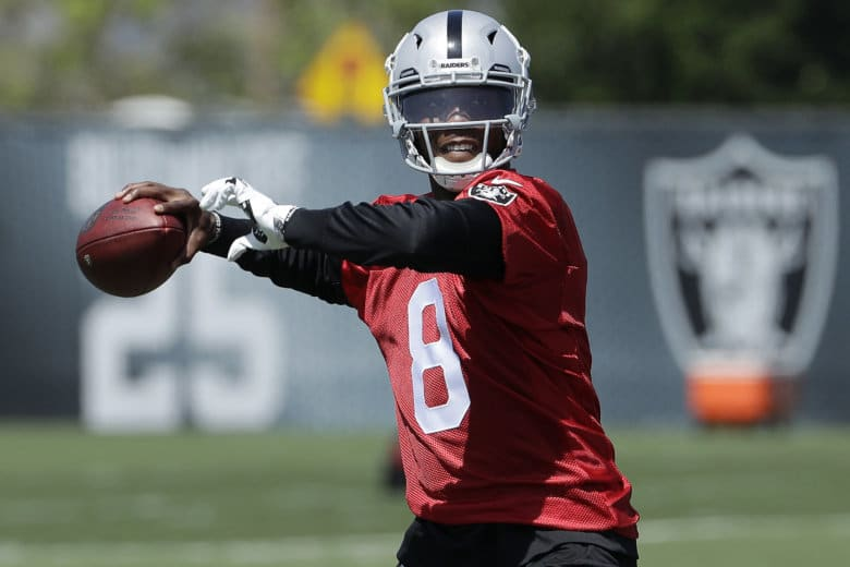 Oakland Raiders quarterback Josh Johnson passes during practice at the  team s NFL football facility in Alameda 9c2f3862f