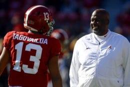 Alabama quarterback Tua Tagovailoa (13) talks with Alabama offensive coordinator Mike Locksley before the start of an NCAA college football game against Mississippi State, Saturday, Nov. 10, 2018, in Tuscaloosa, Ala. (AP Photo/Butch Dill)