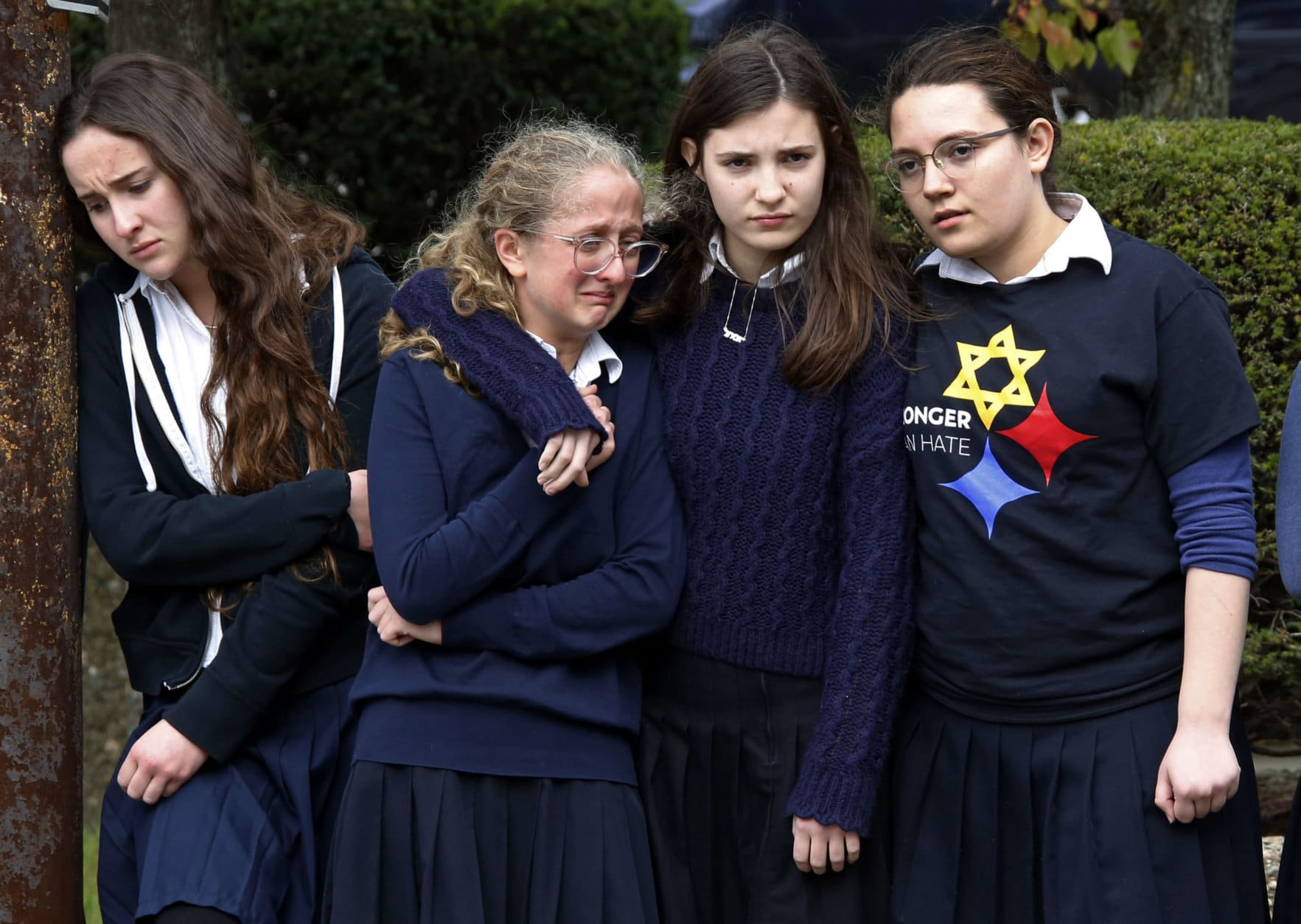 Students from the Yeshiva School in the Squirrel Hill neighborhood of Pittsburgh pay their respects as the funeral procession for Dr. Jerry Rabinowitz passes their school en route to Homewood Cemetery on Oct. 30, 2018, following a funeral service at the Jewish Community Center. Rabinowitz was one of several people killed in a mass shooting while worshipping at the Tree of Life synagogue three days earlier. (AP Photo/Gene J. Puskar)