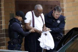 Bill Cosby is escorted out of the Montgomery County Correctional Facility in Eagleville, Pa., on Sept. 25, 2018, following his sentencing to a three-to-10-year prison sentence for sexual assault. (AP Photo/Jacqueline Larma)