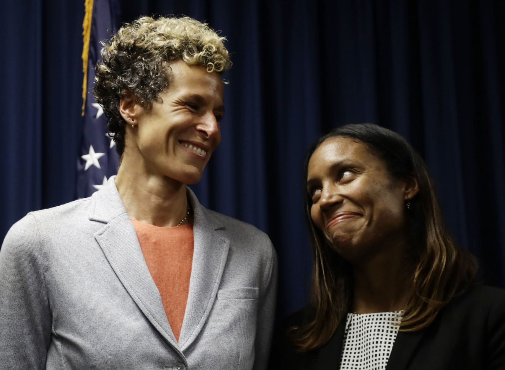 Accuser Andrea Constand, left, reacts at a news conference with prosecutor Kristen Feden after Bill Cosby was sentenced to three to 10 years for sexual assault on Sept. 25, 2018, in Norristown, Pa. (AP Photo/Matt Slocum)