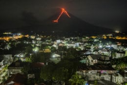 Lava flows down the slopes of the Mayon volcano in the Philippines, seen from Legazpi city, 340 kilometers (210 miles) southeast of Manila, on Jan. 16, 2018. (AP Photo/Dan Amaranto)
