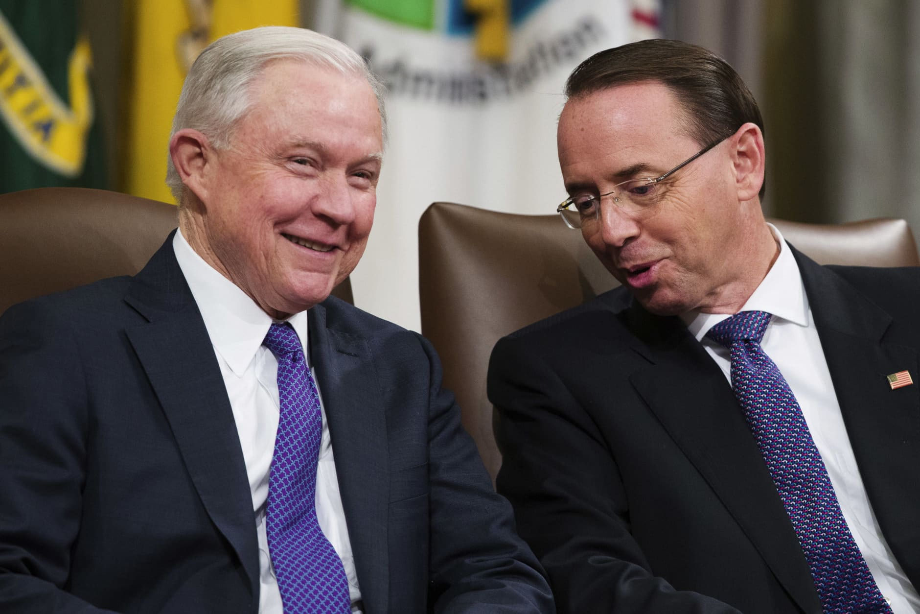 Attorney General Jeff Sessions, left, and Deputy Attorney General Rod Rosenstein, talk during an event to announce new strategic actions to combat the opioid crisis at the Department of Justice's National Opioid Summit in Washington on Oct. 25, 2018. (AP Photo/Alex Brandon)