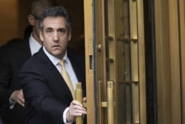 Michael Cohen leaves Federal court in New York on Aug. 21, 2018, after pleading guilty to charges including campaign finance fraud stemming from hush money payments to porn actress Stormy Daniels and ex-Playboy model Karen McDougal. (AP Photo/Mary Altaffer)
