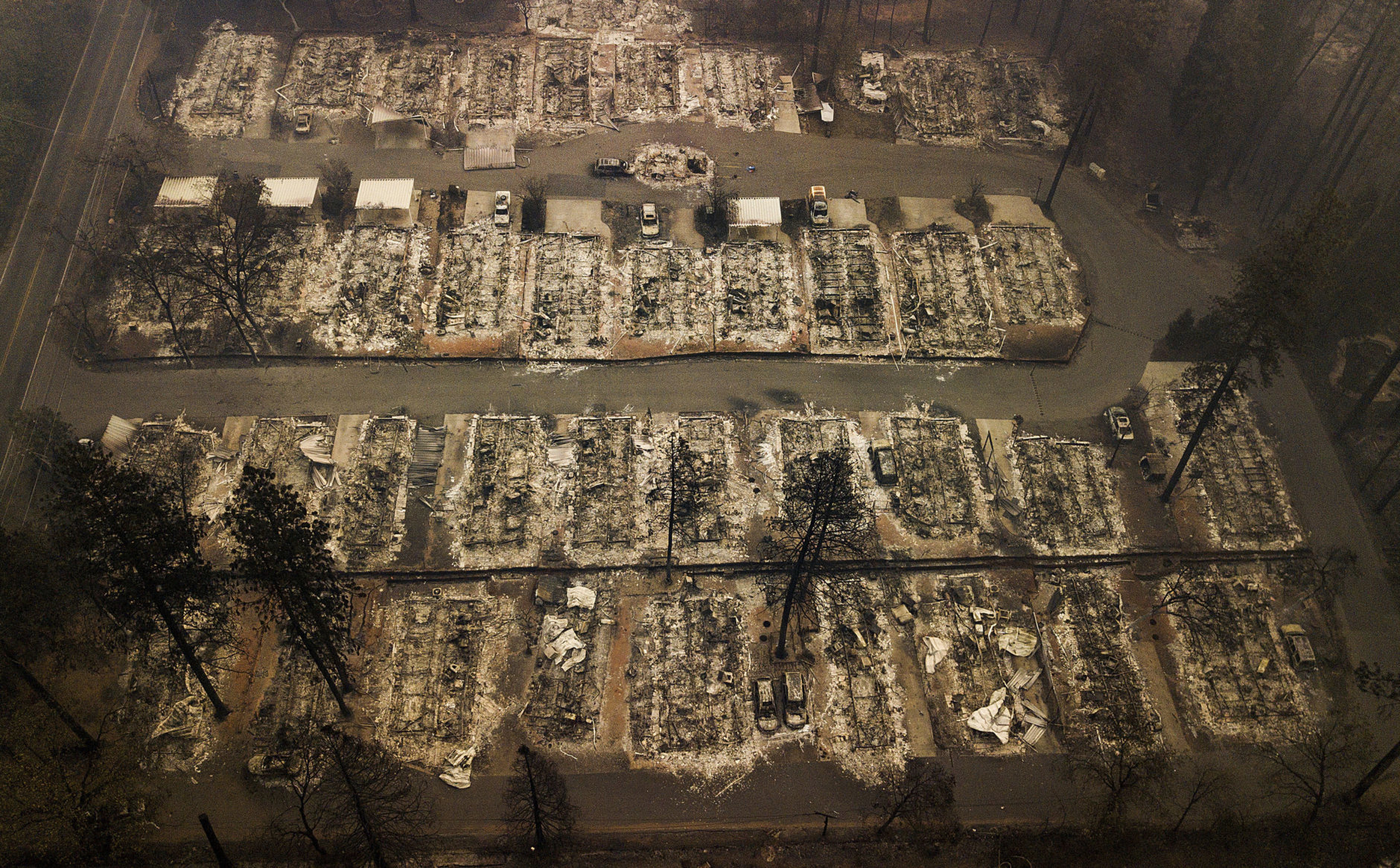 Ashes and debris are all that remain where houses once stood in Paradise, Calif., on Nov. 15, 2018, after a wildfire destroyed the town. (AP Photo/Noah Berger)