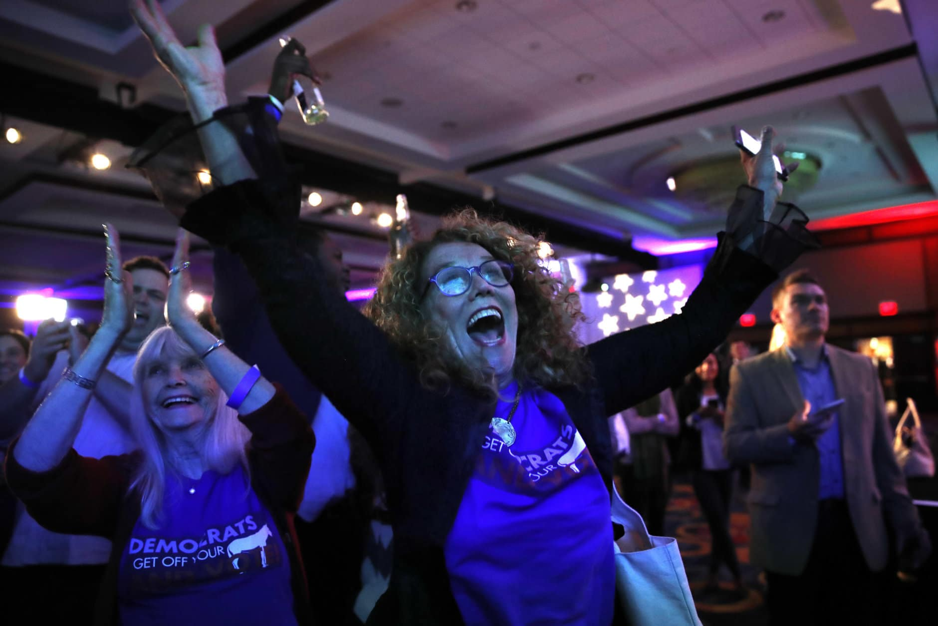 Sydney Crawford, 84, left, of New York, and JoAnn Loulan, 70, of Portola Valley, Calif., cheer as election returns come in during a Democratic party election night event at the Hyatt Regency Hotel in Washington on Tuesday, Nov. 6, 2018. (AP Photo/Jacquelyn Martin)