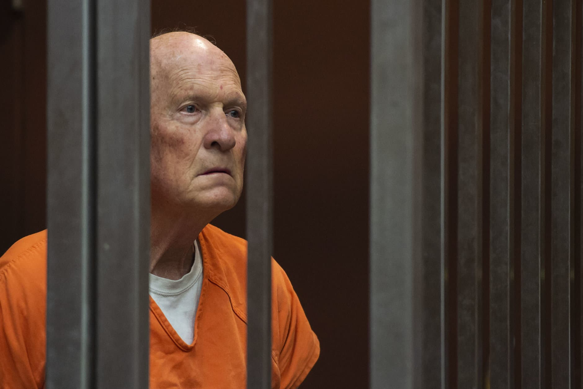 Former police officer Joseph James DeAngelo, accused of being the Golden State Killer, stands in a Sacramento, Calif., jail court on May 29, 2018, as a judge weighs how much information to release about his arrest. DeAngelo is suspected in at least a dozen killings and roughly 50 rapes in the 1970s and '80s. (Paul Kitagaki Jr./The Sacramento Bee via AP, Pool)