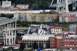 Cars are blocked on the Morandi highway bridge after a large section of it collapsed in Genoa, Italy, on Aug. 14, 2018, during a sudden and violent storm. (AP Photo/Antonio Calanni)